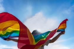 Young woman waving lgbti flag