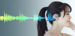 Young woman wearing a bone conduction headphones.