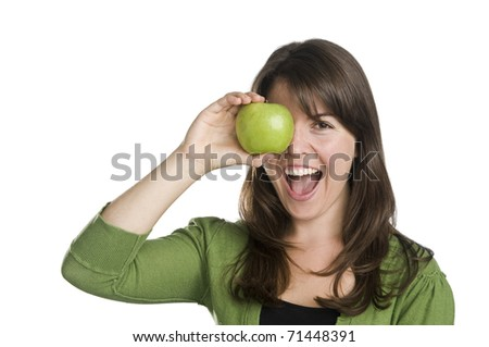 young woman wearing a green top interacting with a green apple, copy space,expressions