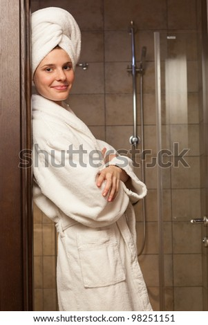 Young woman wearing a white robe in the hotel