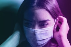 Young woman wearing face surgical mask against corona virus - Fear girl quarantine for preventing pandemic spread of coronavirus - Mental health impact during covid19 and anxiety people concept
