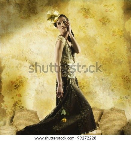 Young woman wearing fancy clothes