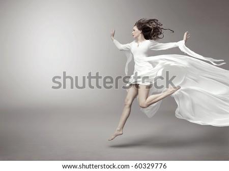 Young woman wearing fashionable dress - stock photo