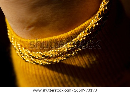 young woman wearing gold bracelet