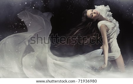 Young woman wearing gorgeous white dress