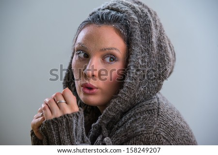 Young woman wearing hoodie warming after cooling in snow. Frost makeup #158249207