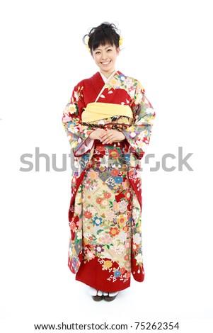 Young woman wearing Japanese kimono, isolated on white background. - stock photo