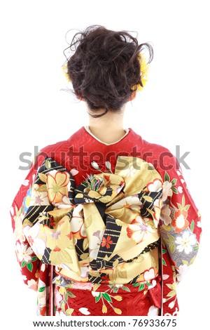 Young woman wearing Japanese kimono, isolated on white background.
