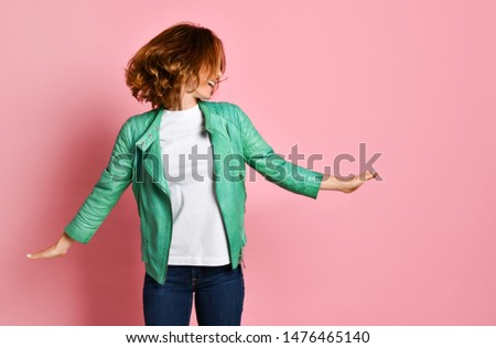 young woman wearing jeans and a jacket is shaking her head with her hair. The concept of joy, happiness, joy, fun #1476465140
