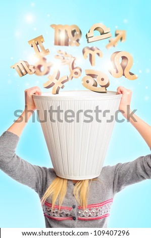 Young woman wearing lampshade and zodiac symbols falling inside. Young female head is busy with horoscope predictions concept. Typical girls leisure