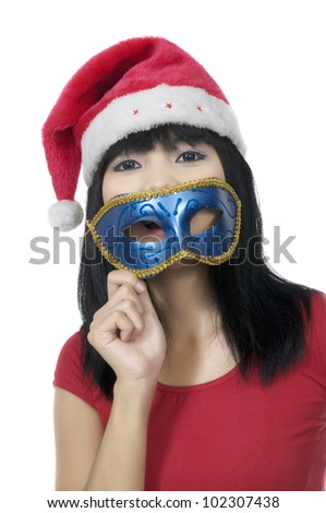 Young woman wearing mask on the christmas. Shoot over white background