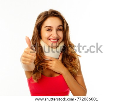 Young woman wearing medical collar over white background #772086001