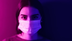 Young woman wearing medical mask against corona virus - Fear girl quarantine for preventing pandemic spread of coronavirus - Mental health impact for covid19 and anxiety people concept