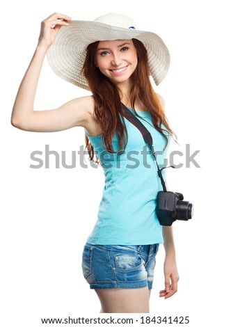 Young woman wearing summer hat is preparing for a trip, isolated over white