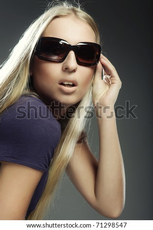 Young woman wearing the big modern sunglasses