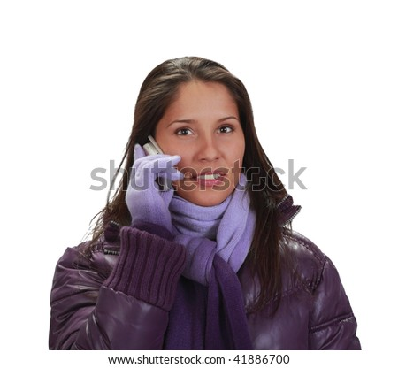 Young woman wearing winter clothes using a mobile phone,isolated against a white background.