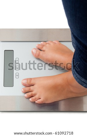 Young woman weighing herself - isolated on white