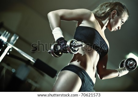 Young woman weight training Camera angle view.