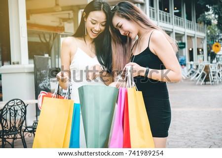 Young woman while enjoying a day shopping