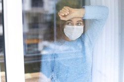 Young woman who cannot leave the house in quarantine due to an epidemic Covid-19
