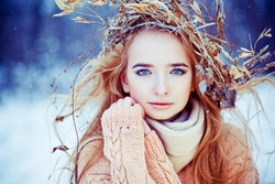 Young woman winter fashion portrait with wreath on her head. Soft light and colors
