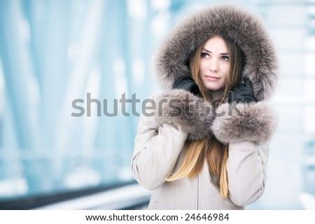 Young woman winter portrait. On abstract tech background.