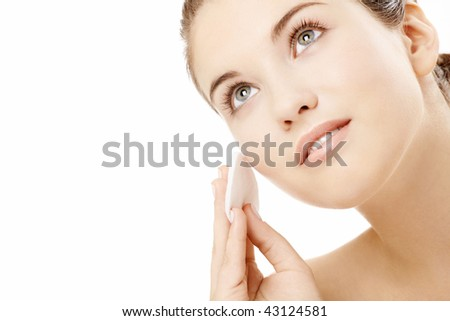Young woman wipes a face skin, isolated