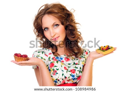 young woman with a beautiful cake. isolated on a white background - stock photo