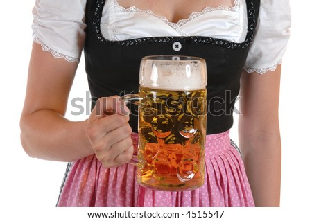 Young woman with a beer mug, dressed in a Bavarian dirndl