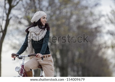 Photo of Young woman with a bicycle