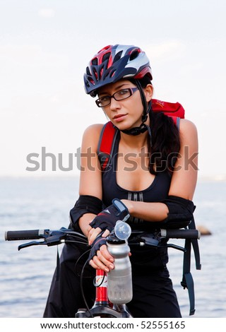 Young woman with a bike