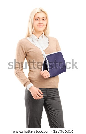 Young woman with a broken arm wearing arm brace isolated on white background