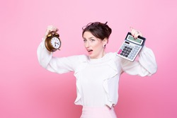 Young woman with a clock and a calculator in her hands panics from rush and lack of time. How to do everything. The problem of time management