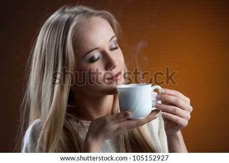 young woman with a cup of coffee in hand