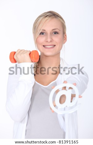 Young woman with a dumbbell and an internet sign