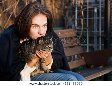 young woman with a gray striped cat