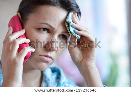 young woman with a handkerchief and a cold call the doctor