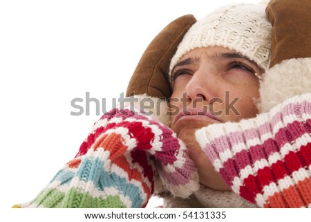 Young woman with a headache on winter (isolated on white)