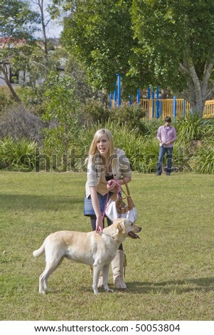 young woman with a labrador dog in the park