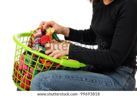 Young woman with a laundry basket full of socks