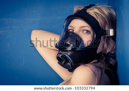 Young woman with a mask closeup