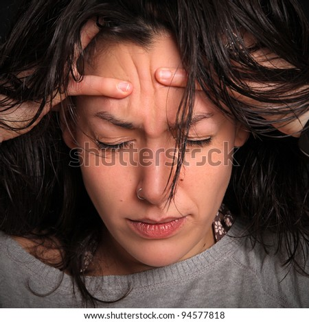 young woman with a splitting headache
