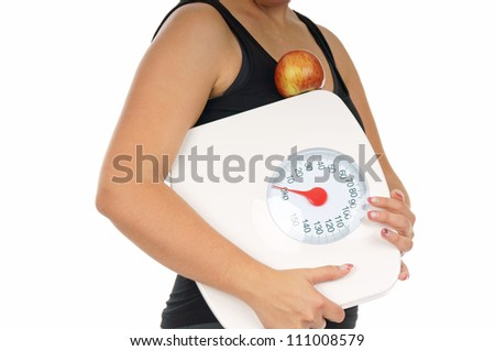 young woman with a weight scale and an apple