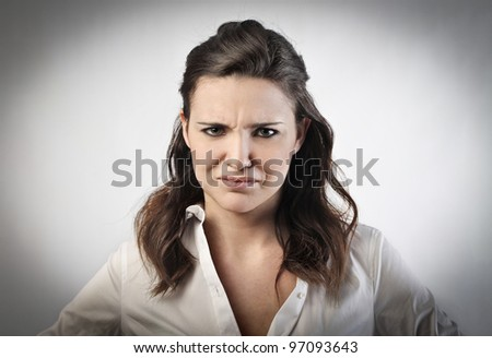 Young woman with aggressive expression