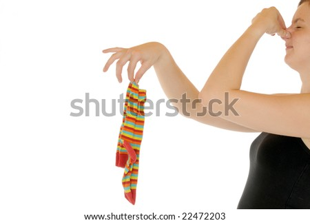 Young woman with an old sock in her fingers