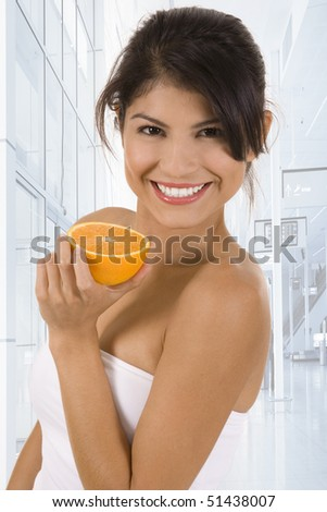 Young woman with an orange.