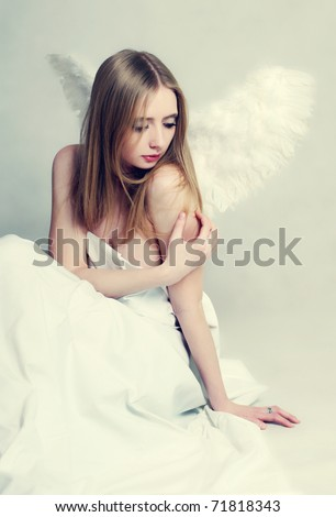 Young woman with angel wings