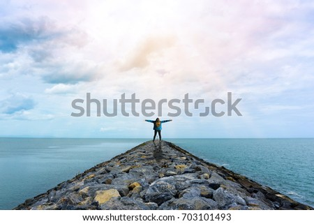 Young woman with arms raised in the sky with sunlight ,Winner success concept, Freedom concept