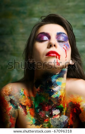 stock photo young woman with art oil paints over naked body and disorderly stack in layers of make up on face 67096318 stock photo : Young woman with art oil paints over naked body and disorderly ...