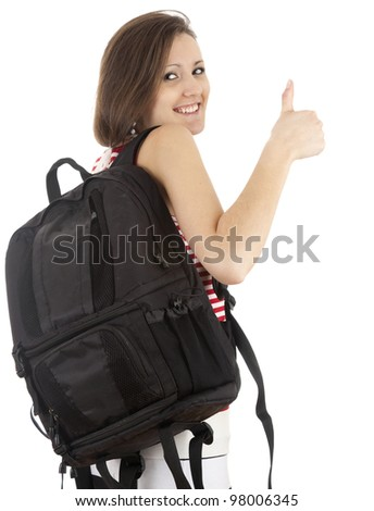 young woman with backpack and thumb up, white background